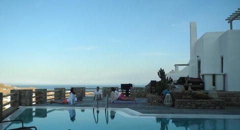 Swimming pool, Leisure, Resort, Azure, Reflection, Aqua, Resort town, Palm tree, Leisure centre, Seaside resort,