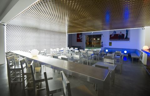 Interior design, Glass, Ceiling, Transparent material, Restaurant, Interior design, Couch, Barware, Hall, Engineering,