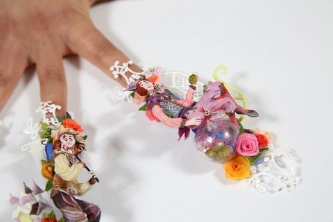 Finger, Wrist, Fashion accessory, Nail, Cut flowers, Toy, Creative arts, Artificial flower, Ring, Body jewelry,