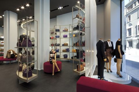 Lighting, Interior design, Suit, Shelf, Shelving, Retail, Luggage and bags, Collection, Light fixture, Outlet store,