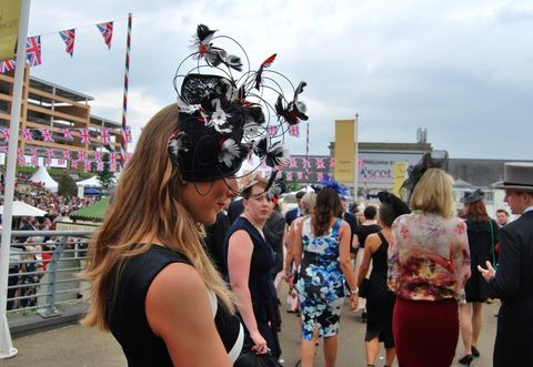 Dress, Tourism, Fashion accessory, Hat, Crowd, Luggage and bags, Sleeveless shirt, Sun hat, Flag, Bag,