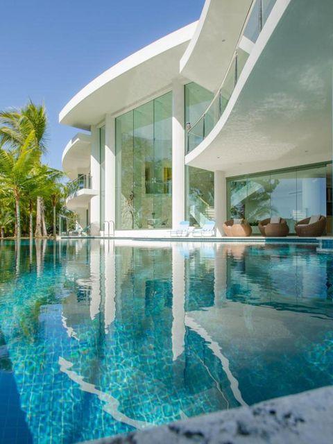 Swimming pool, Property, Reflection, Real estate, Resort, Azure, Villa, Aqua, Composite material, Tile,