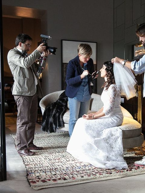 Interior design, Floor, Interior design, Conversation, Carpet, Bridal clothing, Wedding dress, Ceremony, Gown, Couch,