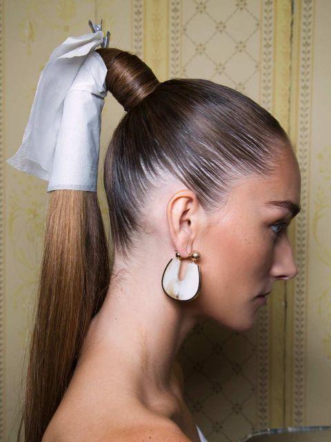 Ear, Earrings, Hairstyle, Forehead, Eyebrow, Body piercing, Eyelash, Style, Jaw, Organ,