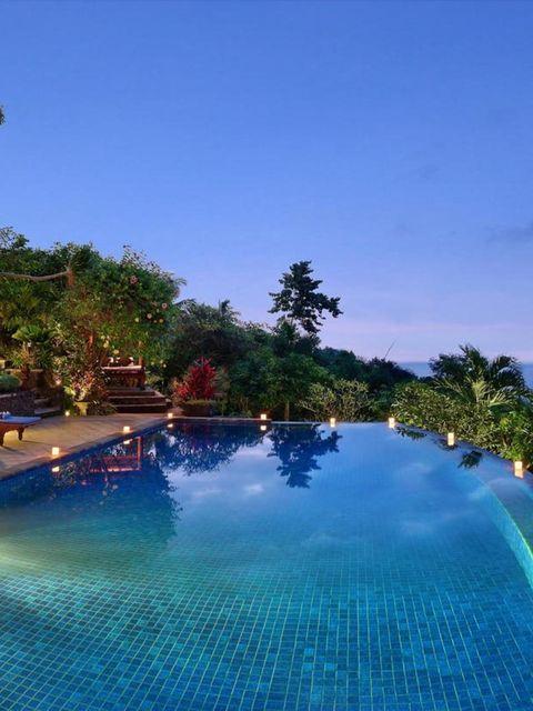 Swimming pool, Resort, Leisure, Town, Majorelle blue, Real estate, Azure, Resort town, Tropics, Aqua,