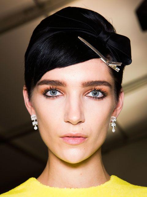 Ear, Lip, Yellow, Hairstyle, Skin, Chin, Forehead, Eyelash, Eyebrow, Fashion accessory,
