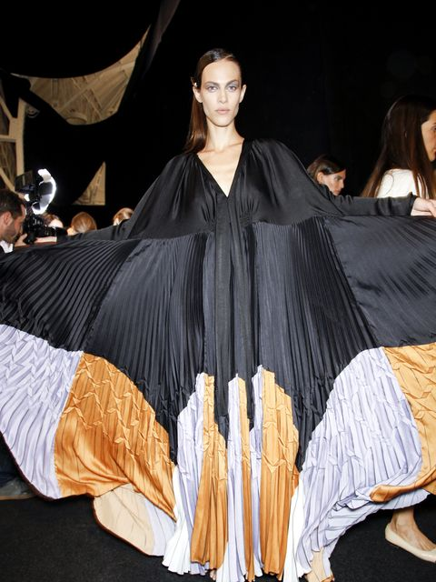 Costume design, Formal wear, Dress, Costume, Fashion, Youth, Fashion model, Gown, Haute couture, One-piece garment,
