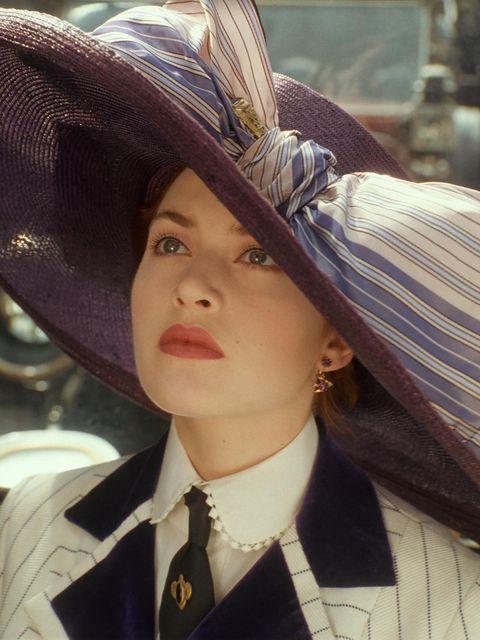 Dress shirt, Collar, Hat, Headgear, Costume accessory, Sun hat, Costume hat, Costume, Tradition, Button,