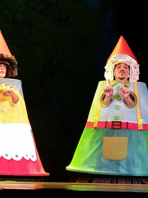 Costume design, Headgear, Costume accessory, Costume, Cone, Costume hat, Toy, Stage, Fashion design, Headpiece,