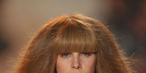 Lip, Brown, Hairstyle, Shoulder, Bangs, Beauty, Long hair, Brown hair, Fashion, Chest,