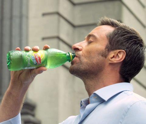 Dress shirt, Green, Bottle, Shirt, Drinkware, Collar, Neck, Facial hair, Drink, Beard,
