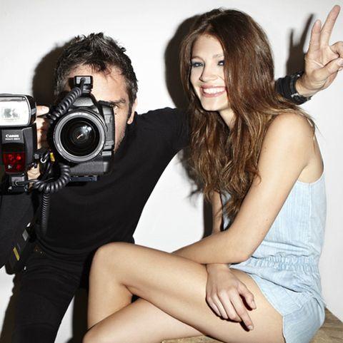 Hair, Arm, Finger, Photographer, Lens, Camera, Film camera, Digital camera, Hand, Camera accessory,