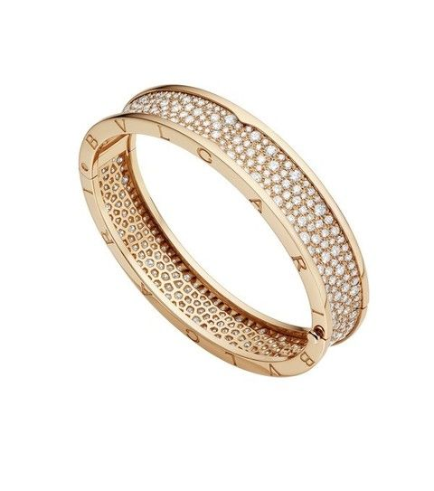 Jewellery, Fashion accessory, Metal, Ring, Gemstone, Beige, Body jewelry, Natural material, Circle, Pre-engagement ring,