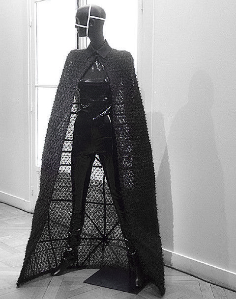 Standing, Floor, Sculpture, Monochrome, Costume design, Costume, Armour, Mannequin, Fashion design, Mantle,