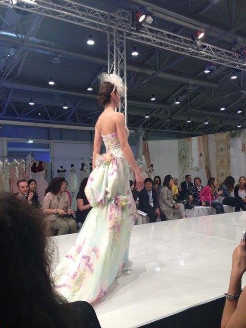 Hairstyle, Shoulder, Fashion show, Dress, Style, Gown, Runway, Fashion model, Fashion accessory, Fashion,