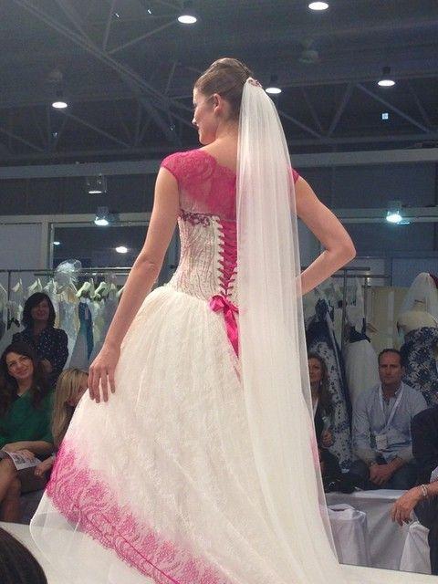 Face, Bridal clothing, Shoulder, Textile, Gown, Pink, Formal wear, Wedding dress, Dress, Fashion,