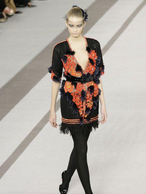 Clothing, Fashion show, Sleeve, Human body, Shoulder, Human leg, Textile, Joint, Fashion model, Runway,