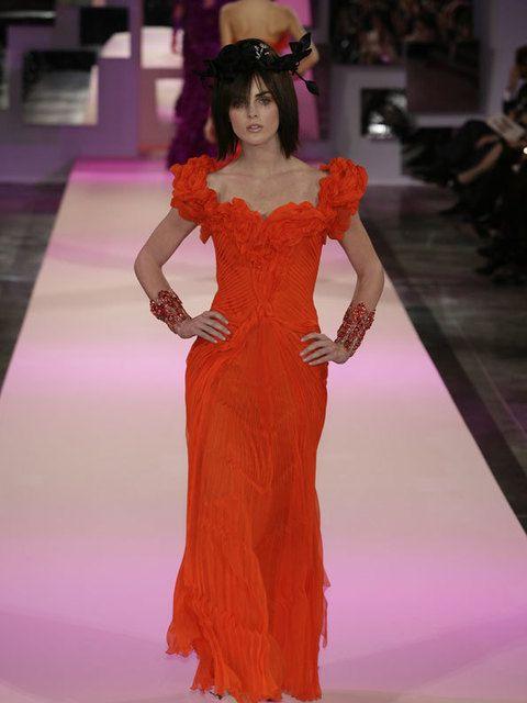 Shoulder, Dress, Style, Formal wear, Fashion show, One-piece garment, Waist, Fashion model, Flooring, Fashion accessory,