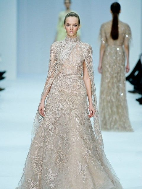 Clothing, Shoulder, Dress, Joint, Formal wear, Style, Fashion show, Gown, Fashion model, One-piece garment,