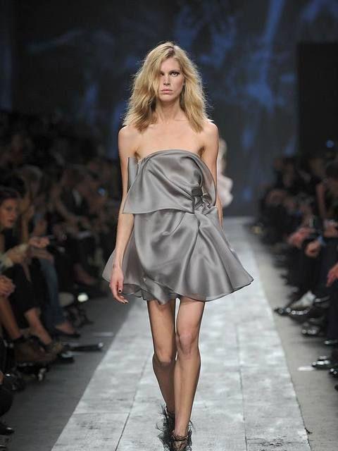 Clothing, Footwear, Fashion show, Shoulder, Runway, Joint, Human leg, Fashion model, Dress, Style,