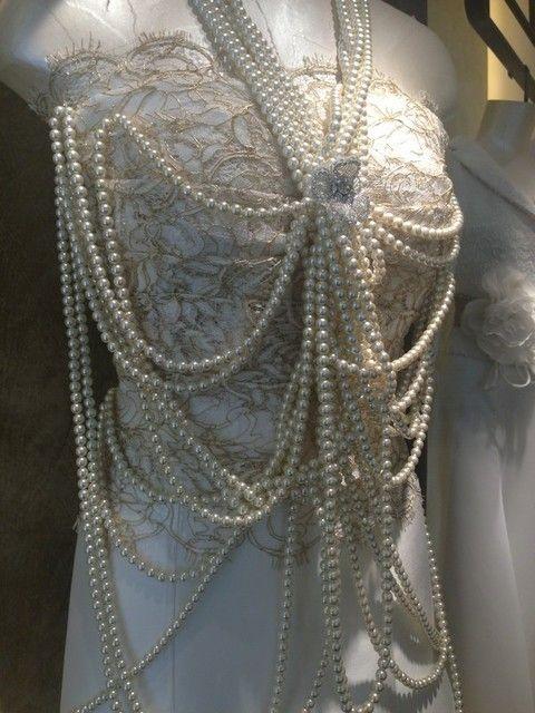Bridal accessory, Headgear, Embellishment, Fashion, Natural material, Metal, Mannequin, Lace, Silver, Fashion design,