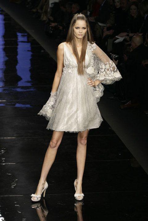 Hairstyle, Shoulder, Dress, Human leg, Fashion show, One-piece garment, Style, Fashion model, Formal wear, Fashion,