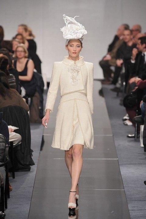 Leg, Fashion show, Event, Runway, Shoulder, Outerwear, Fashion model, Style, Dress, Fashion accessory,