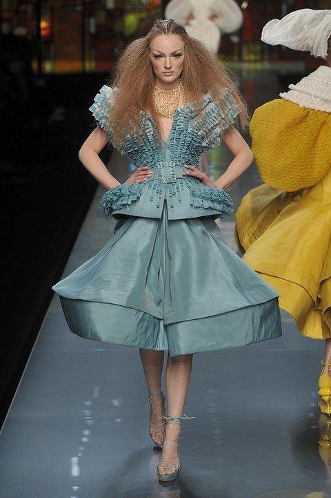 Clothing, Dress, Textile, Style, Fashion show, Costume design, Fashion model, One-piece garment, Fashion accessory, Headgear,