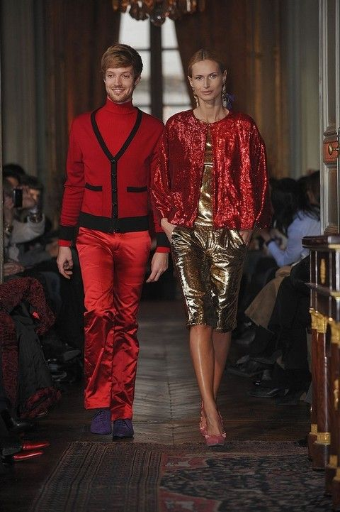 Red, Fashion, Maroon, Curtain, Runway, Waist, Light fixture, Fashion design, Carpet, Fashion show,