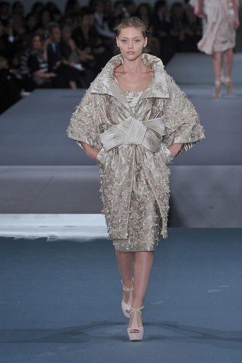 Clothing, Leg, Fashion show, Human body, Event, Shoulder, Dress, Runway, Joint, Fashion model,