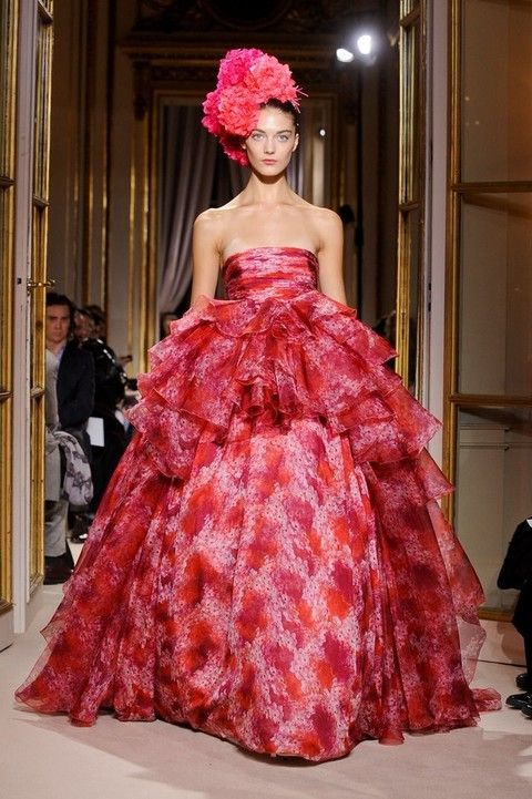 Dress, Red, Textile, Fashion show, Gown, Style, Pink, Formal wear, Fashion model, One-piece garment,