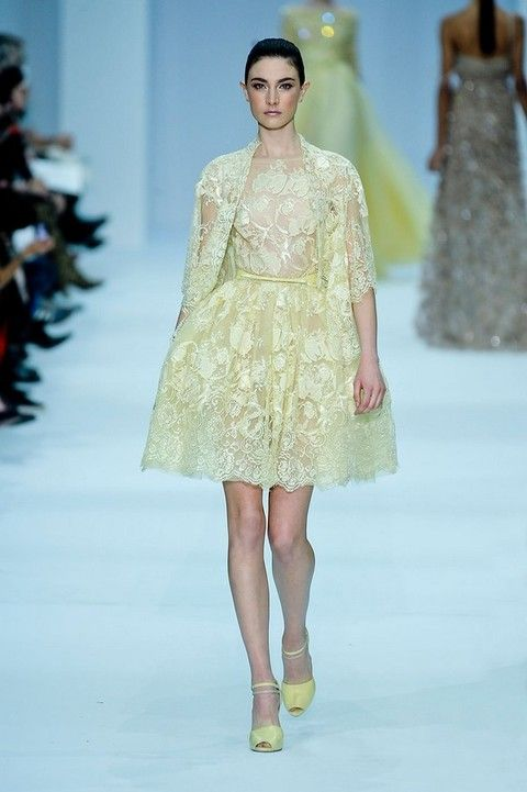 Clothing, Yellow, Fashion show, Event, Shoulder, Dress, Textile, Runway, Joint, Waist,