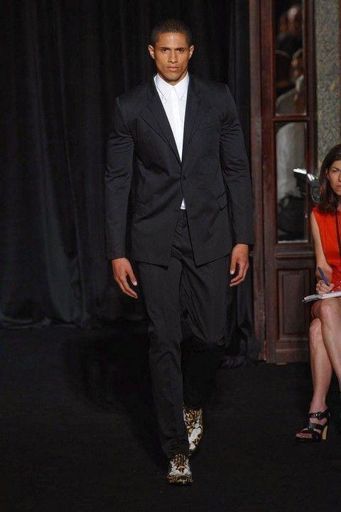 Clothing, Footwear, Leg, Coat, Dress shirt, Microphone, Collar, Trousers, Human body, Suit trousers,