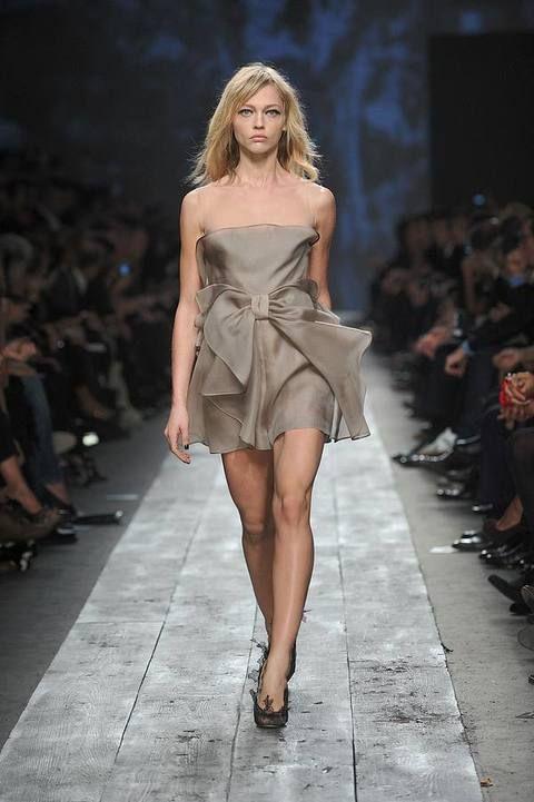 Clothing, Footwear, Hairstyle, Fashion show, Shoulder, Human leg, Dress, Runway, Joint, Fashion model,