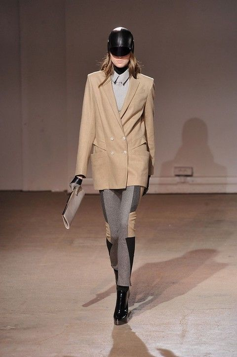 Clothing, Brown, Sleeve, Coat, Human body, Shoulder, Textile, Joint, Fashion show, Outerwear,