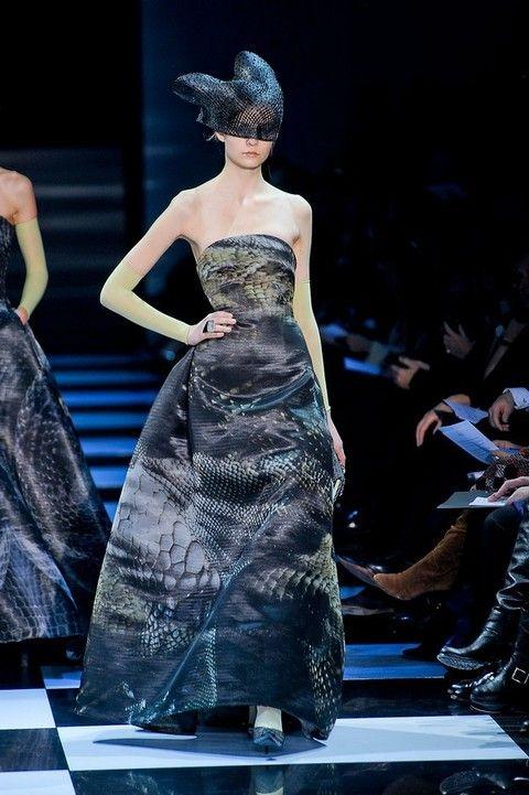 Fashion show, Dress, Shoulder, Runway, Formal wear, Fashion model, Style, Gown, One-piece garment, Fashion,