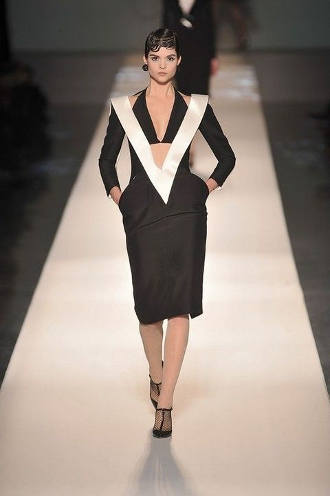 Clothing, Fashion show, Sleeve, Shoulder, Runway, Joint, Outerwear, Human leg, Fashion model, Style,