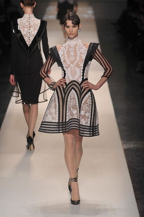 Clothing, Fashion show, Dress, Shoulder, Runway, Joint, Human leg, Fashion model, Style, One-piece garment,