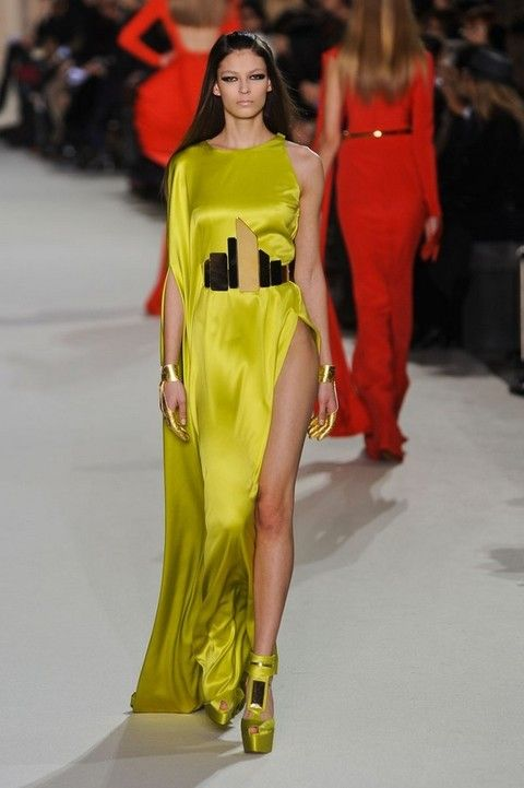 Clothing, Yellow, Fashion show, Shoulder, Joint, Red, Fashion model, Dress, Runway, Waist,