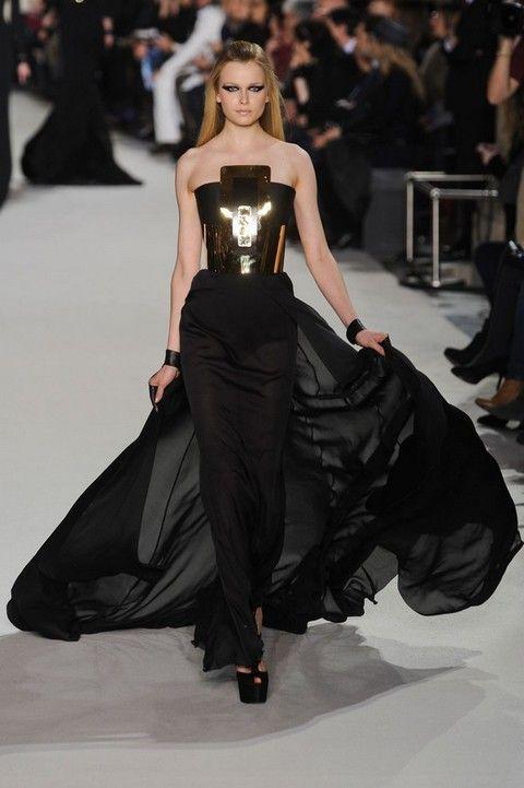 Human, Fashion show, Hairstyle, Shoulder, Runway, Dress, Joint, Outerwear, Fashion model, Waist,