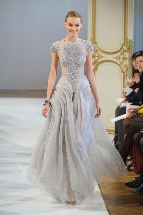 Dress, Shoulder, Joint, Bridal clothing, Formal wear, Gown, Style, Wedding dress, Fashion show, One-piece garment,