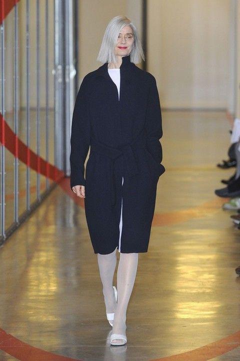 Sleeve, Shoulder, Fashion show, Joint, Floor, Outerwear, Flooring, Style, Runway, Formal wear,