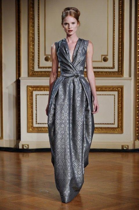 Floor, Shoulder, Flooring, Dress, Fashion show, One-piece garment, Style, Formal wear, Fashion model, Hardwood,