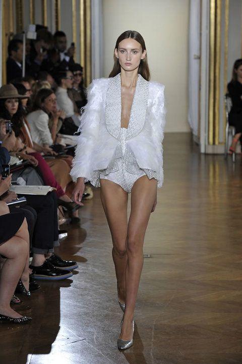 Face, Leg, Fashion show, Hat, Human body, Human leg, Shoulder, Runway, Style, Fashion model,