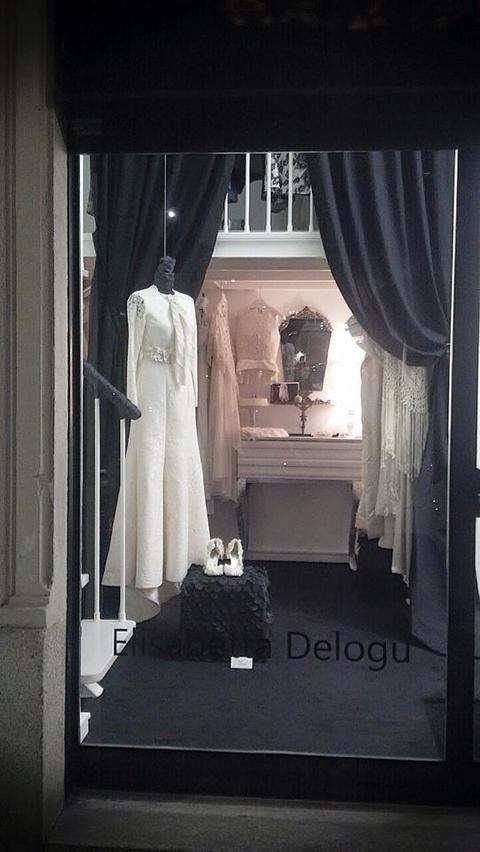 Dress, Textile, Interior design, Mannequin, Window treatment, Curtain, One-piece garment, Boutique, Display window, Wedding dress,