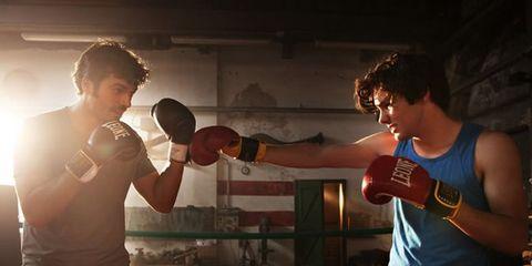 Arm, Human body, Elbow, Hand, Muscle, Contact sport, Chest, Trunk, Sleeveless shirt, Guitar,