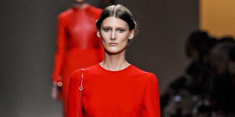 Ear, Lip, Sleeve, Shoulder, Red, Style, Fashion show, Fashion model, Fashion, Neck,