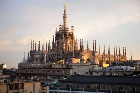 City, Landmark, Spire, Holy places, Evening, Place of worship, Tourist attraction, Finial, Dusk, Classical architecture,