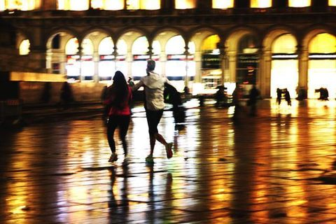 Standing, Amber, Light, Shadow, Arch, Reflection, Tints and shades, Travel, Walking, Pedestrian,