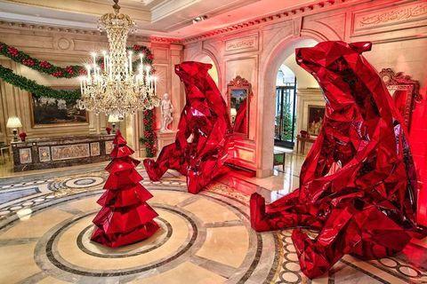 Lighting, Interior design, Red, Interior design, Hall, Light fixture, Carmine, Sculpture, Ceiling, Art,
